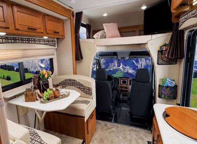 Class C Buying An RV guide interior Photo. If you have never been in an RV or this is your first time buying an RV you are probably confused as to what the difference between a Class C & Class B RV are. While the features, amenities & floor plan can greatly change between manufacturer and year the main difference is a Class C RV has a bed/sleeping area directly over the drivers seat while a Class B RV does not. So when buying an RV now you will know the difference between a Class B RV & Class C RV.