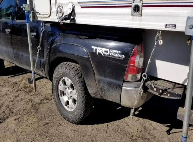 A close up view of the truck tie down made out of chain link, Dring, chain repair link and one turn buckle. Is all I needed to make my own truck camper tie downs.
