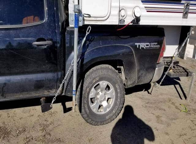 As you can see both my truck camper tie downs are attached to the cabover camper and the frame mounted anchor point. Securing the truck camper to my toyota tacoma.