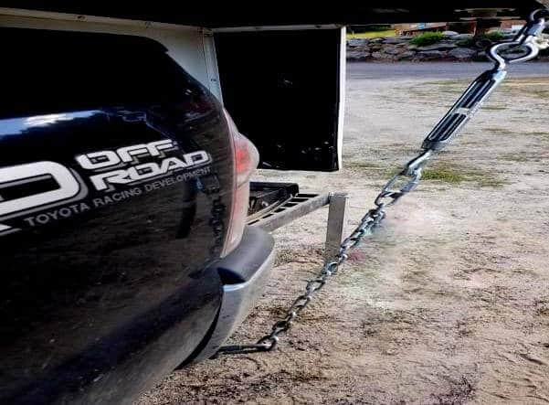 If you want to save hundreds of dollars it only takes 20 minutes to make your own truck camper tie downs. As you can see in this picture I used two feet of chain. Two D-rings and a turn buckle. Super easy to make your own truck camper tie downs.