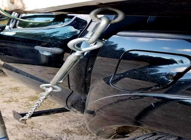 All you need to make your own slide in truck camper frame mounted tie downs. Is a pliers, length of chain, D-rings & four turnbuckles. Its that simple to make your own cabover camper truck tie downs.