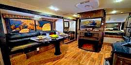 Before buying a camper I visited over 50 RV dealerships to get an idea of the floor plan I wanted to call home. My favorite camper floor plan included a slide out, fireplace, office work space and a couch with a fold down table. Campers have this wonderful transformer technology and I love everything about them. Salesman must think I am always buying a camper, but in reality I go to camper and RV trade shows to get an idea of whats available. I am happy with my current setup, but if I am ever in the market to buy a new camper I want to know whats the norm & whats not. My next camper will for surely have a fireplace in my workstation next to the couch dinner table.