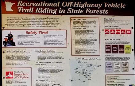 ATV safety rules and regulations by the Minnesota DNR posted on sign in the Spider Lake Trails Recreational area.