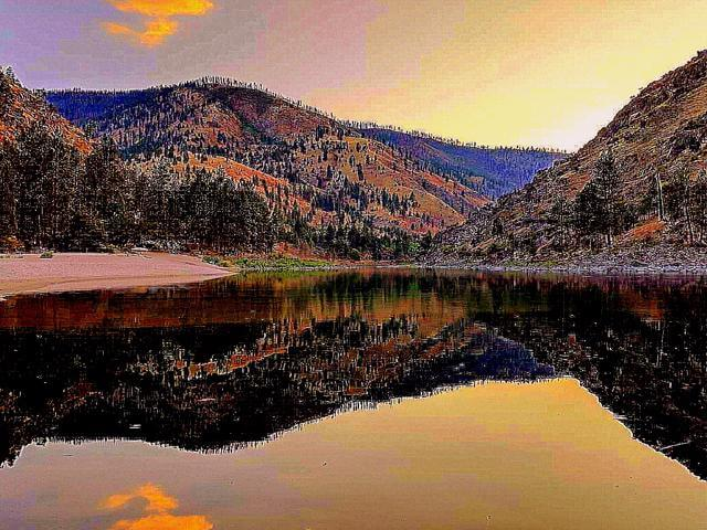 Private beach on Salmon River near Riggs Idaho. Free camping with 30 foot travel trailer.