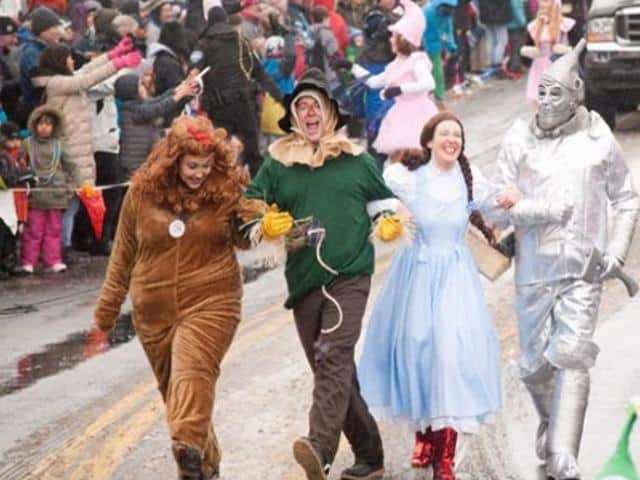 Parade patrons dressed up like wizard of oz characters at the McCall Winter carnival Parade