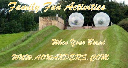 Two zorbing balls waiting at the top of the holl to roll down with participants. When your bored and looking for a good time you gotta try zorbing!!