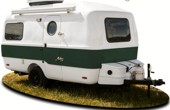Happier Camper is fiberglass shell travel trailer with a full galley kitchen and bathroom. Including shower and queen size bedroom.